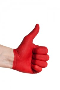 a red painted hand showing one thumb up, isolated